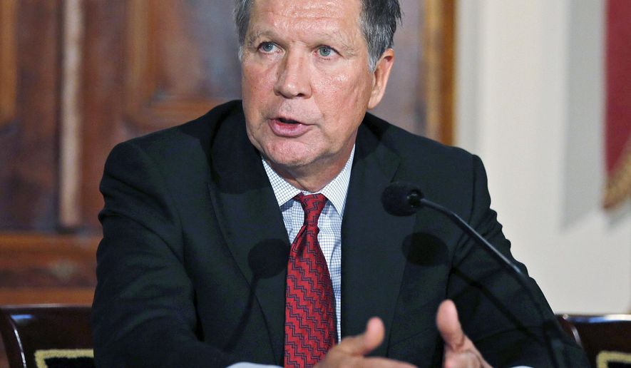FILE - In this Dec. 5, 2014 file photo, Ohio Gov. John Kasich announces a new task force to improve community-police relations at the Statehouse in Columbus, Ohio. Kasich signed 40 bills  into law Friday, Dec. 19, 2014. (AP Photo/Columbus Dispatch, Jonathan Quilter, File)