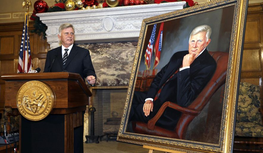 Arkansas Gov. Mike Beebe looks at his portrait after the oil painting was unveiled at the state Capitol in Little Rock, Ark., Friday, Dec. 19, 2014. (AP Photo/Danny Johnston)