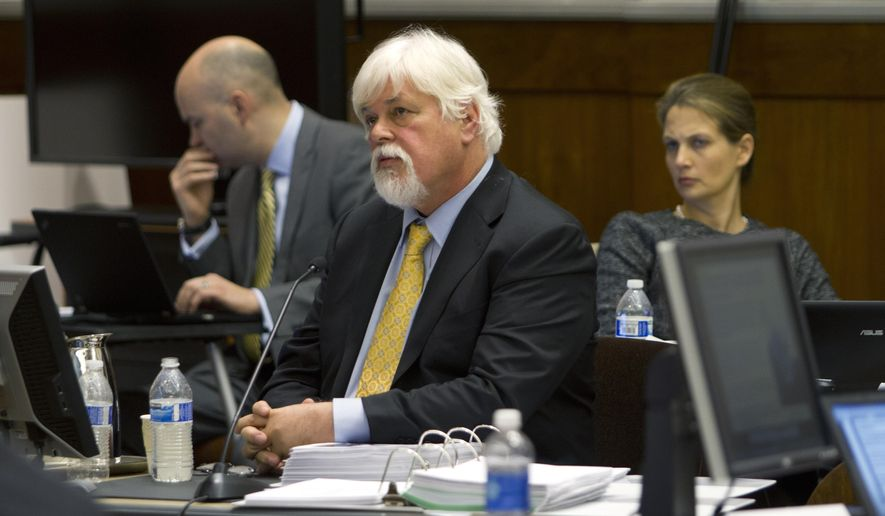 File - This Nov. 6, 2013 file photo shows anti-whaling activist Paul Watson, center, founder of the Oregon-based Sea Shepherd Conservation Society, as he listens during a contempt of court hearing in federal court in Seattle. Radical environmentalists have been found in contempt of court for failing to heed an order to halt their relentless campaign to disrupt the annual whale hunt off the waters of Antarctica. The 9th U.S. Circuit Court of Appeals on Friday, Dec. 19, 2014 ordered a lower court to determine how much Watson and members of the Sea Shepherd Conservation Society owe Japanese whalers. (AP Photo/Karen Ducey, Pool, file)