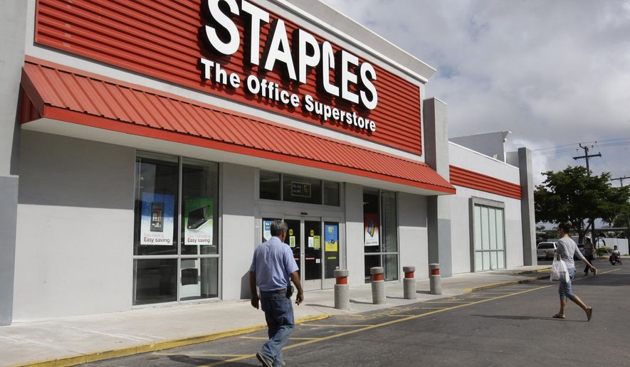 FILE - In this Nov. 15, 2011, file photo, a Staples office supply store is photographed in Miami. Staples Inc. says nearly 1.2 million customer payment cards may have been exposed during a security breach earlier in 2014. (AP Photo/Lynne Sladky, File)