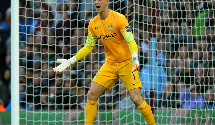 FILE - In this Saturday, Oct. 4, 2014 file photo, Manchester City's Joe Hart during the English Premier League soccer match between Aston Villa and Manchester City at Villa Park, Birmingham, England.  England goalkeeper Joe Hart has signed a new contract with Manchester City through 2019, it was announced on Friday, Dec. 19, 2014.  (AP Photo/Rui Vieira, File)