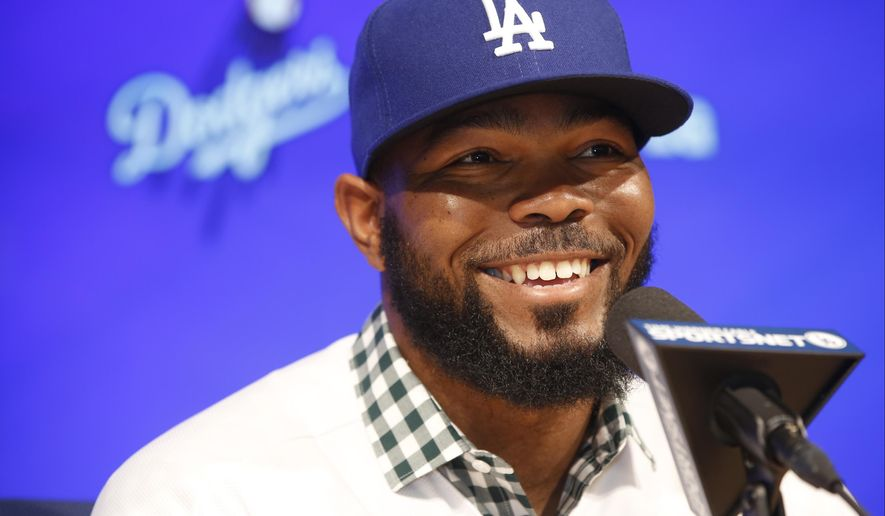 Los Angeles Dodgers baseball player Howie Kendrick takes questions from the media at an introductory news conference at Dodger Stadium in Los Angeles Friday, Dec. 19, 2014. (AP Photo/Damian Dovarganes)