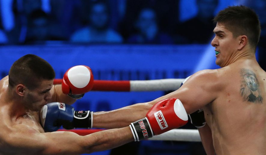 Former NBA player Darko Milicic, right, fights against Radovan Radojcin during their kickboxing match at the Soul Night of Champions, in Novi Sad, Serbia, Thursday, Dec. 18, 2014. Milicic is switching from basketball to kickboxing. (AP Photo/Darko Vojinovic)