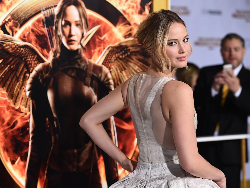 """Jennifer Lawrence arrives at the Los Angeles premiere of """"The Hunger Games: Mockingjay - Part 1"""" at the Nokia Theatre L.A. Live on Monday, Nov. 17, 2014. (Photo by Jordan Strauss/Invision/AP)"""