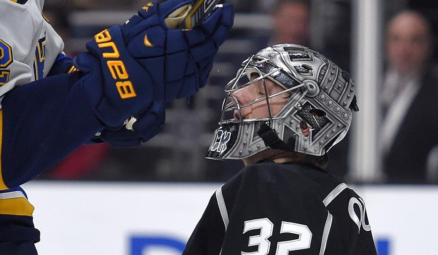 St. Louis Blues center David Backes, left, celebrates after scoring against Los Angeles Kings goalie Jonathan Quick during the first period of an NHL hockey game, Thursday, Dec. 18, 2014, in Los Angeles. (AP Photo/Mark J. Terrill)