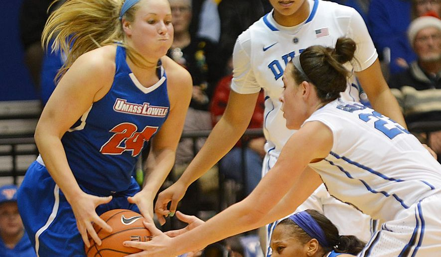 Duke's Rebecca Greenwell, right, and Massachusetts Lowell's Melissa Frase (24) vie for a loose ball during an NCAA college basketball game Friday, Dec. 19, 2014, in Durham, N.C. (AP Photo/The Herald-Sun, Bernard Thomas)