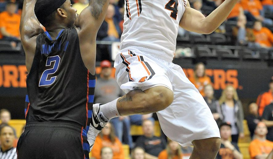 Oregon State's Victor Robbins takes a shot over DePaul's Tommy Hamilton IV in the first half of an NCAA college basketball game Thursday, Dec. 18, 2014, in Corvallis, Ore. (AP Photo/The Gazette-Times, Andy Cripe)