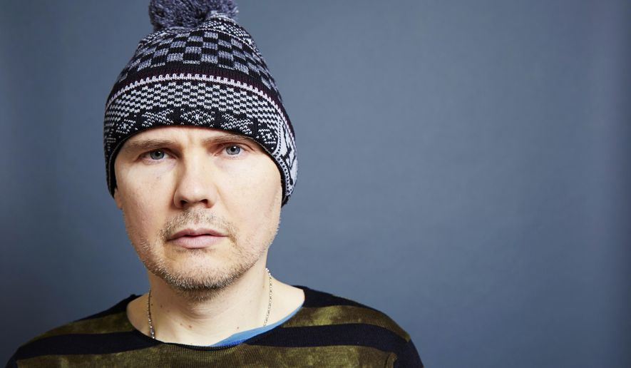 "In this Dec. 9, 2014 photo, Smashing Pumpkins frontman Billy Corgan poses for a portrait in promotion of the band's new album ""Monuments To An Elegy"" in New York. (Photo by Dan Hallman/Invision/AP)"