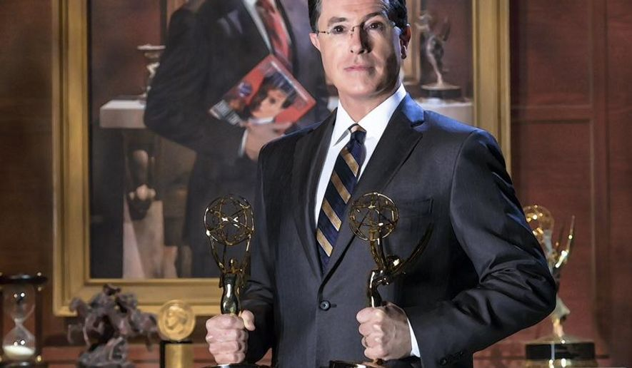 """This handout photo provided by the Smithsonian shows Stephen Colbert poising in front of his portrait. Colbert's image is returning to the Smithsonian's National Portrait Gallery. To mark the end of Colbert's nine-year persona on Comedy Central's """"The Colbert Report,"""" the museum borrowed Colbert's portrait. The picture was created for the show's final season. Now the new iteration of Colbert's portrait will be installed Friday at the museum. It will be displayed through April 19, once again between the bathrooms and above a water fountain. (AP Photo/Smithsonian)"""