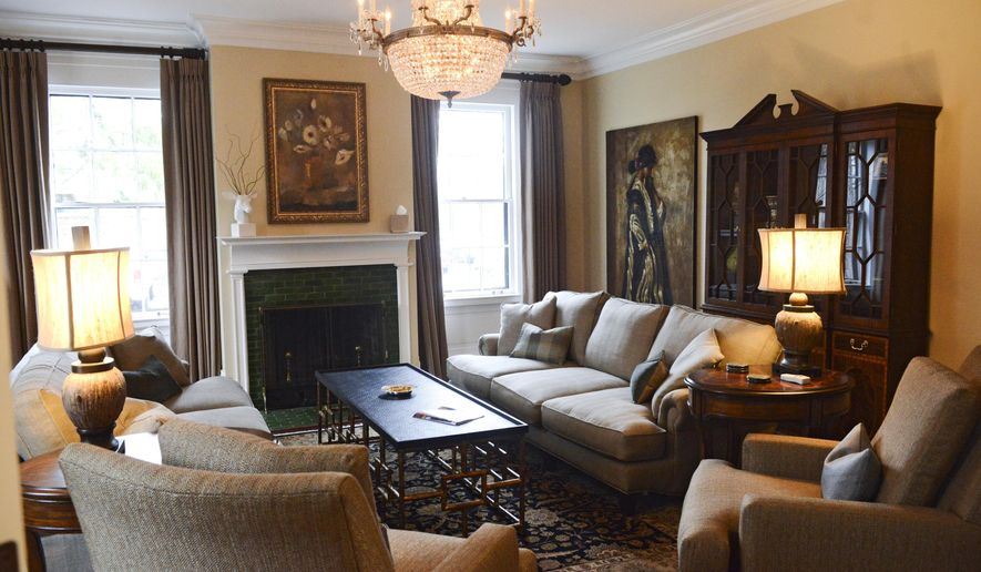 This photo taken on Dec. 11, 2014, shows the living room of the Sanford House in Grand Rapids, Mich., that has been restored to serve as a meeting and media room for the home's residents. (AP Photo/The Grand Rapids Press, Emily Rose Bennett) ALL LOCAL TELEVISION OUT; LOCAL TELEVISION INTERNET OUT