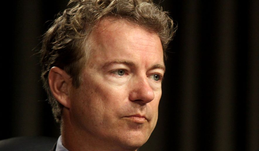 FILE - In this April 1, 2014 file photo, Sen. Rand Paul, R-Ky. listens on Capitol Hill in Washington. Paul is taking online digs at potential GOP rival Sen. Marco Rubio, R-Fla. over President Barack Obama's new Cuba policy.  (AP Photo/Lauren Victoria Burke, File)