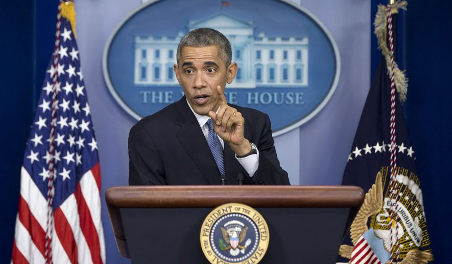 President Barack Obama speaks during a news conference in the Brady Press Briefing Room in Washington, Friday, Dec. 19, 2014. The president claimed an array of successes in 2014, citing lower unemployment, a rising number of Americans covered by health insurance, and an historic diplomatic opening with Cuba. He also touts his own executive action and a Chinese agreement to combat global warming. (AP Photo/Carolyn Kaster)