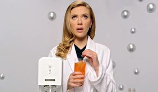 Scarlett Johansson uses SodaStream products in a 2014 Super Bowl commercial. (Associated Press) ** FILE **