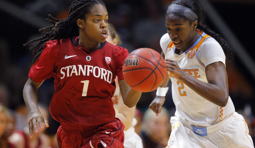 Stanford guard Lili Thompson (1) brings the ball up court as she's chased by Tennessee forward Jasmine Jones (2) in the first half of an NCAA college basketball game, Saturday, Dec. 20, 2014, in Knoxville, Tenn. (AP Photo/Wade Payne)