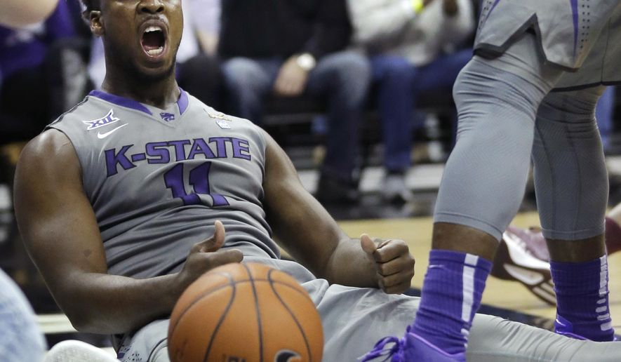 Kansas State forward Nino Williams (11) celebrates a basket and being fouled during the first half of an NCAA college basketball game against Texas A&M in Kansas City, Mo., Saturday, Dec. 20, 2014. (AP Photo/Orlin Wagner)