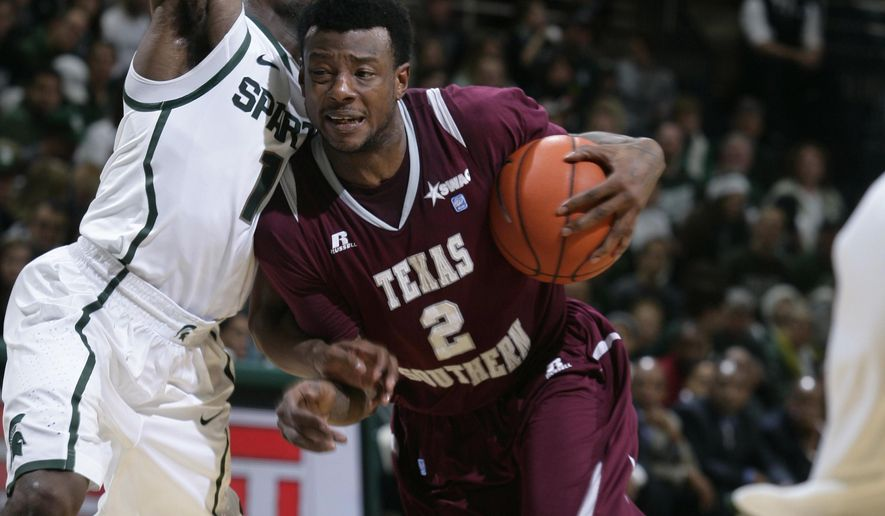 Texas Southern's Chris Thomas (2) drives against Michigan State's Lourawls Nairn Jr. during the first half of an NCAA college basketball game, Saturday, Dec. 20, 2014, in East Lansing, Mich. (AP Photo/Al Goldis)