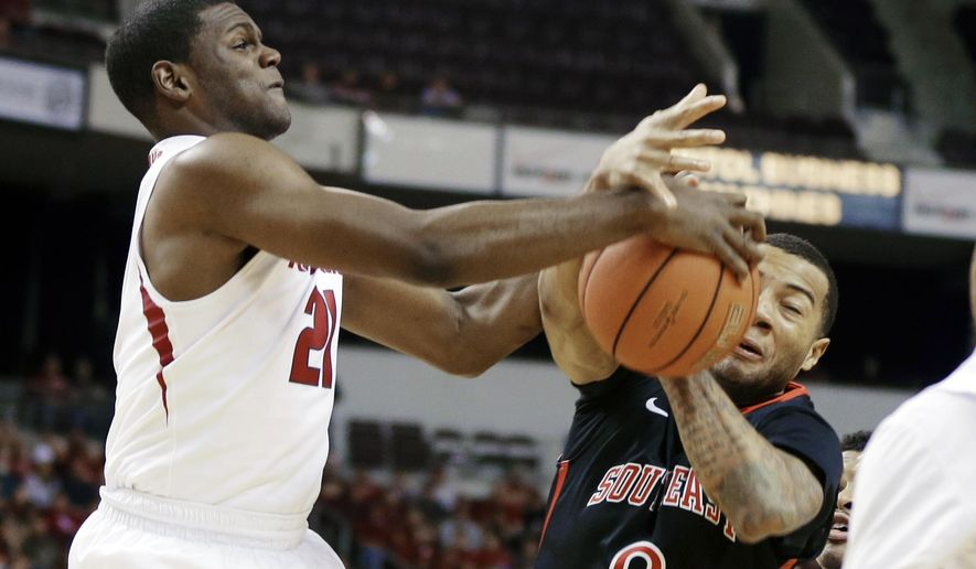 Arkansas's Manuale Watkins (21) takes the ball away from Southeast Missouri State's Josh Langford (0) in first half of an NCAA college basketball game in North Little Rock, Ark., Saturday, Dec. 20, 2014. (AP Photo/Danny Johnston)