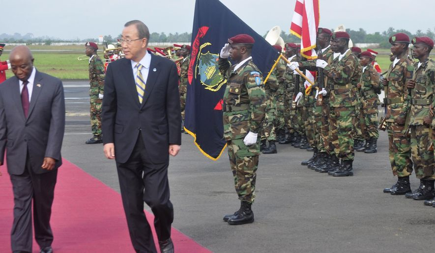 "UN Secretary General Ban Ki-moon, centre, inspects the honor guard upon arrival at the Roberts international airport in Monrovia, Liberia, Friday, Dec. 19, 2014. United Nations Secretary-General Ban Ki-moon praised health workers battling Ebola in Sierra Leone and Liberia on Friday, saying they have shown ""the most noble face of humankind"" amid an epidemic that has killed more than 6,900 people in West Africa. Ban, who made stops in both countries on Friday, travels Saturday to Guinea where the Ebola virus first emerged a year ago. (AP Photo/Abbas Dulleh)"