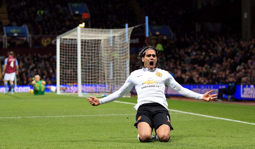 Manchester United's Radamel Falcao celebrates scoring a goal, during the English Premier League soccer match between Aston Villa and Manchester United,  at Villa Park, in Birmingham, England, Saturday Dec.  20, 2014. (AP Photo/PA, Nick Potts) UNITED KINGDOM OUT
