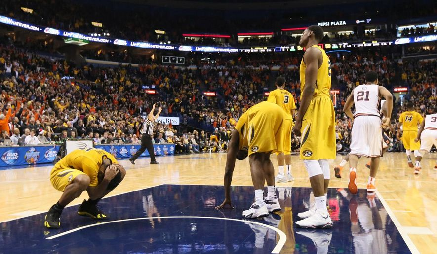 Missouri players, including guard Wes Clark, left, react after Illinois guard Rayvonte Rice, background far right,  made the game-winning three-point shot as time expired during the Braggin' Rights basketball game between Missouri and Illinois in St. Louis, Saturday, Dec. 20, 2014. (AP Photo/St. Louis Post-Dispatch, Chris Lee )  EDWARDSVILLE INTELLIGENCER OUT; THE ALTON TELEGRAPH OUT