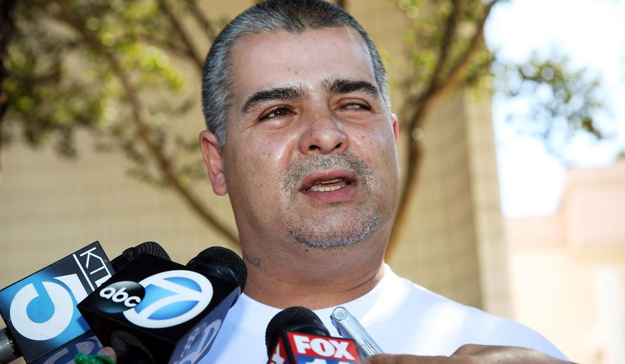 FILE - In this Oct. 2, 2014 file photo, William Crespo, brother of the late Bell Gardens, Calif., Mayor Daniel Crespo, speaks at a news conference in Bell Gardens. An autopsy report for Crespo, who was shot to death by his wife, includes detailed allegations of domestic abuse spanning two decades. Crespo's daughter told investigators hours after the fatal September shooting that her father had become more physically abusive toward her mother in the last two years amid arguments over his infidelity.  (AP Photo/Nick Ut, File)