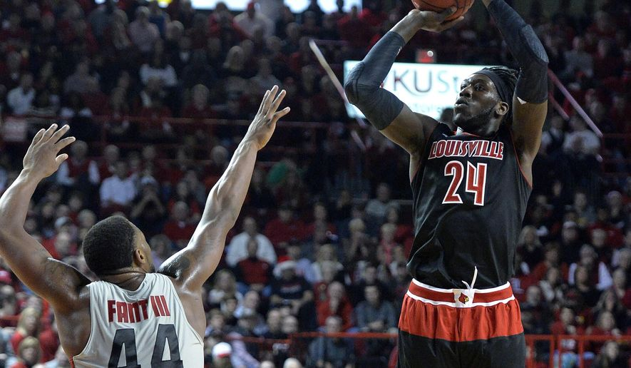 Louisville's Montrezl Harrell, right, puts up a shot over the defense of Western Kentucky's George Fant during the first half of an NCAA college basketball game Saturday, Dec. 20, 2014, in Bowling Green, Ky. (AP Photo/Timothy D. Easley)