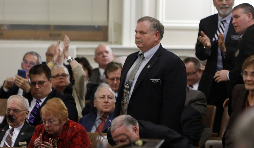 FILE - In this Dec. 3, 2014 file photo, newly elected House Speaker, Rep. Shawn Jasper, R-Hudson, center, walks up the rostrum after being elected at the Statehouse in Concord, N.H.   A new, Republican-led Legislature has laid out its priorities for the upcoming 2015 session, sure to be a bruiser as lawmakers prepare a two-year-spending plan amid flat revenues. (AP Photo/Jim Cole)
