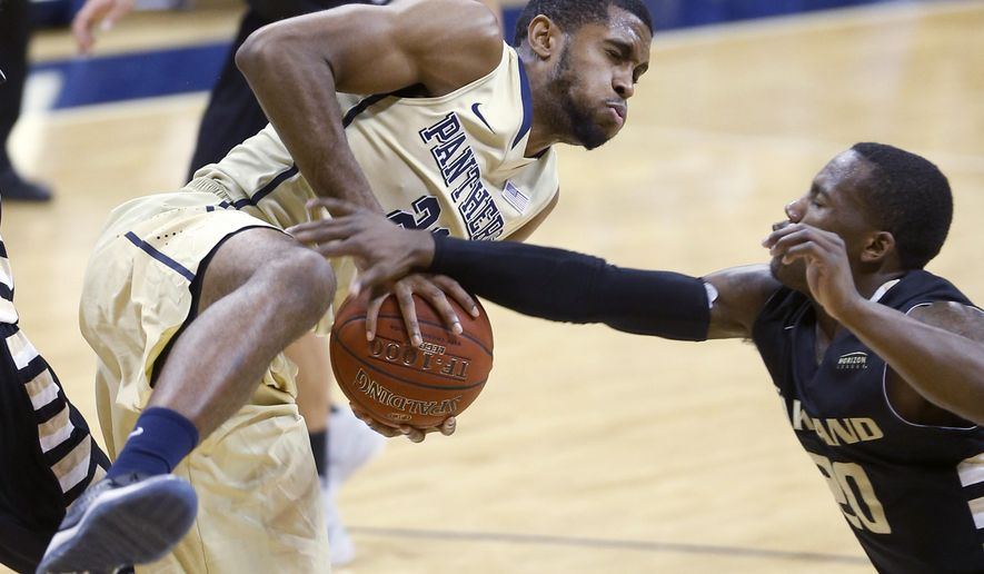 Pittsburgh's Sheldon Jeter, left, grabs a rebound in front of Oakland's Kahlil Felder (20) in the first half of an NCAA college basketball game, Saturday, Dec. 20, 2014, in Pittsburgh. (AP Photo/Keith Srakocic)