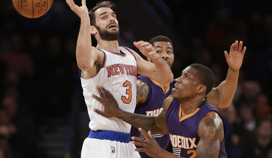 New York Knicks' Jose Calderon (3) loses control of the ball as Phoenix Suns' Eric Bledsoe (2) defends during the first half of an NBA basketball game, Saturday, Dec. 20, 2014, in New York.  (AP Photo/Frank Franklin II)