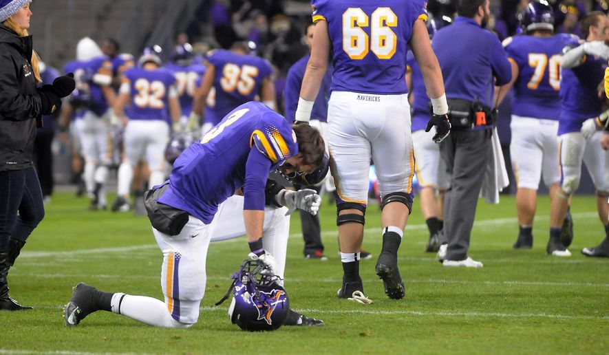 Minnesota State-Mankato's Patrick Schmidt (3) pauses on the field as his teammates head for the locker room after the team's 13-0 loss to Colorado State-Pueblo in the NCAA Division II championship football game Saturday, Dec. 20, 2014, in Kanas City, Kan. (AP Photo/Mankato Free Press, Pat Christman)