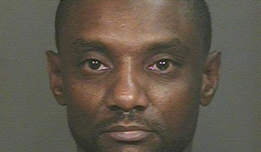 This photo provided by Glendale Police Department, Rickey McGee Brisbon is shown.  Brisbon, of Glendale, was arrested Friday, Dec. 19, 2014,  on an unrelated charge of domestic violence from a June 2013 case. Authorities say they are investigating a claim that Brisbon physically and sexually assaulted a female. The female victim told authorities that Brisbon also threatened to kill her and Officer Mark Rine. Phoenix police say Rine was investigating a tip that Rumain Brisbon was conducting a drug deal Dec. 2 when he mistook a pill bottle in Brisbon's pocket for a gun and shot him. (AP Photo/Glendale Police Department)