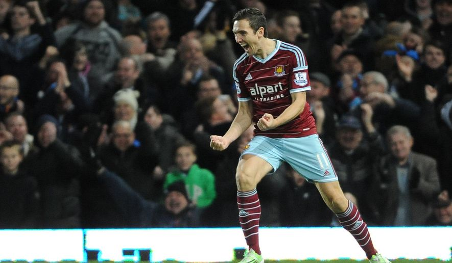 West Ham United's Stewart Downing celebrates scoring their second goal during the English Premier League match between West Ham and Leicester City at Upton Park, London,  Saturday Dec. 20, 2014. (AP Photo/PA, Daniel Hambury)  UNITED KINGDOM OUT  NO SALES  NO ARCHIVE