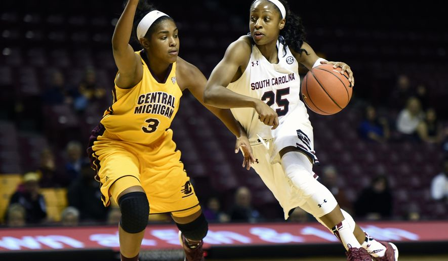 South Carolina guard Tiffany Mitchell (25) drives against Central Michigan guard Jessica Green (3) during the second half of an NCAA college basketball game Saturday, Dec. 20, 2014, in Minneapolis. South Carolina won 80-45. (AP Photo/Hannah Foslien)