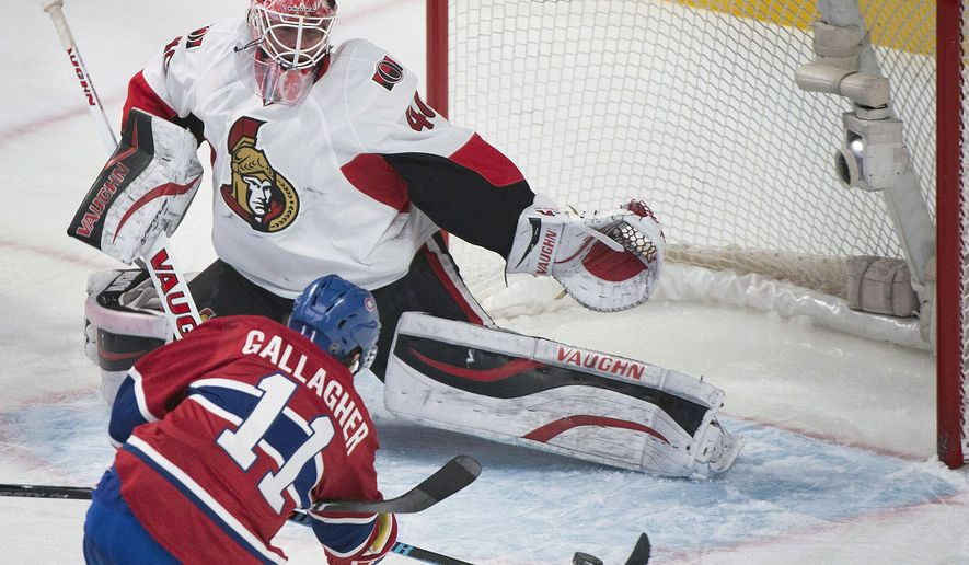 Montreal Canadiens' Brendan Gallagher scores against Ottawa Senators goaltender Robin Lehner during the second period of an NHL hockey game, Saturday, Dec. 20, 2014 in Montreal. (AP Photo/The Canadian Press, Graham Hughes)