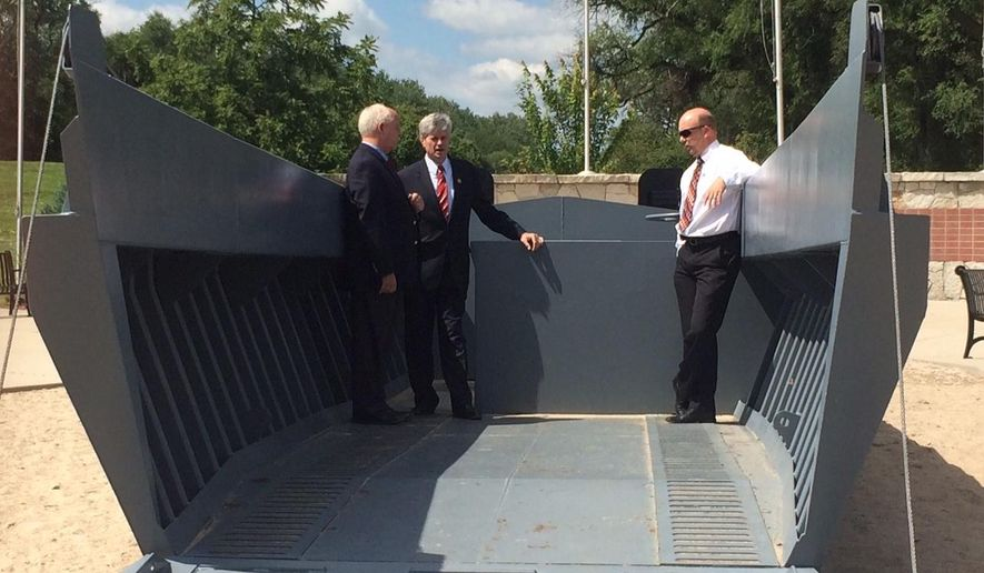 This Aug. 11, 2014 photo provided by the office of U.S. Rep. Jeff Fortenberry, from left, Retired British Major Timothy Kilvert-Jones, Congressman Jeff Fortenberry, and Columbus Area Chamber of Commerce President KC Belitz talk on a replica Higgins Boat in Columbus, Neb.  A local committee is looking for funding to build a second Andrew Jackson Higgins monument  at the site of the D-Day landings in France. More than 1,000 Higgins boats, also known as LCVP landing craft, were used by the Allied Forces during the Normandy landings along the beaches of northern France, which led then-Gen. Dwight Eisenhower to refer to Higgins as the man who won World War II.   (AP Photo/Office of U.S. Rep. Jeff Fortenberry)
