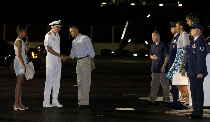 Sasha Obama, left, watches as Admiral Samuel Locklear III, Commander, U.S. Pacific Command, greets President Barack Obama, as first lady Michelle Obama walks with Malia Obama, far right, as the first family arrives at Pearl Harbor, Hawaii to begin their family vacation Friday, Dec. 19, 2014. (AP Photo/Jacquelyn Martin)