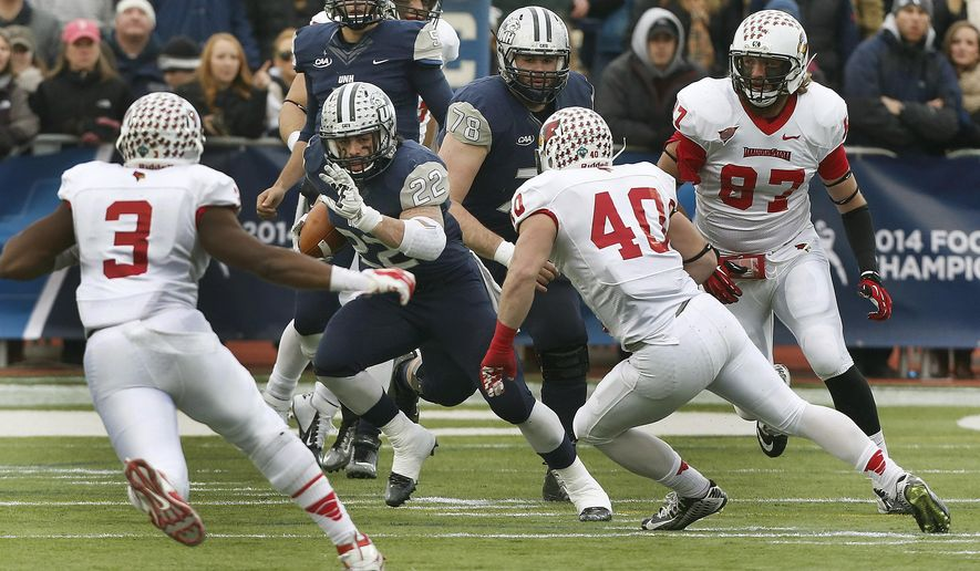 New Hampshire's Nico Steriti (5) looks for room to run against Illinois State's Donte McCoy (3) and Alex Donnelly (40) in the first half of their NCAA FCS semifinal college football game Saturday, Dec. 20, 2014, in Durham,N.H. (AP Photo/Jim Cole)