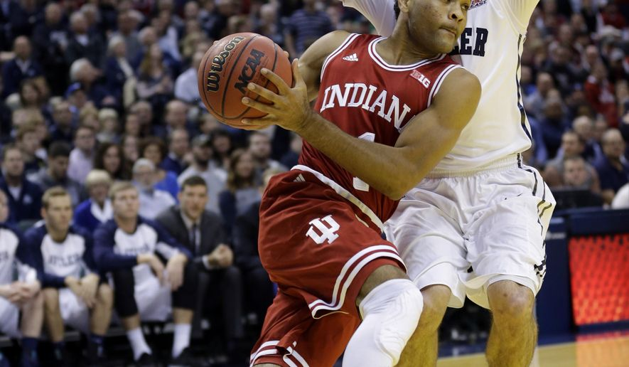 Indiana guard James Blackmon Jr. (1), front, drives past Butler guard Alex Barlow (3) in the first half of an NCAA college basketball game in Indianapolis, Saturday, Dec. 20, 2014. (AP Photo/Michael Conroy)