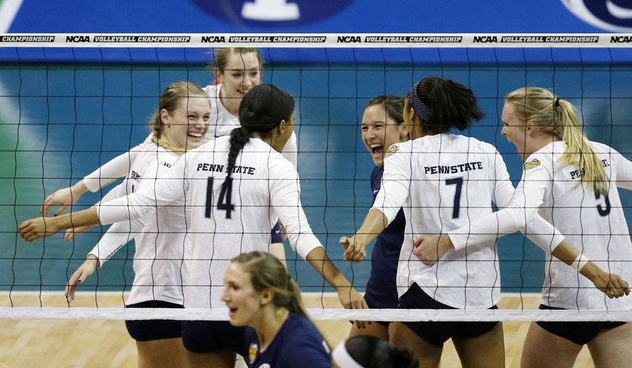 Penn State celebrates a point against BYU during the NCAA women's volleyball tournament championship match in Oklahoma City, Saturday, Dec. 20, 2014. (AP Photo/Sue Ogrocki)
