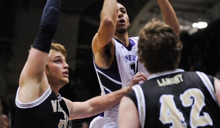 Northwestern  guard Tre Demps, center, shoots past Western Michigan forward Connar Tava (2) and center Drake LaMont (42) during the first half of an NCAA college basketball game Saturday, Dec. 20, 2014, in Evanston, Ill. (AP Photo/Matt Marton)
