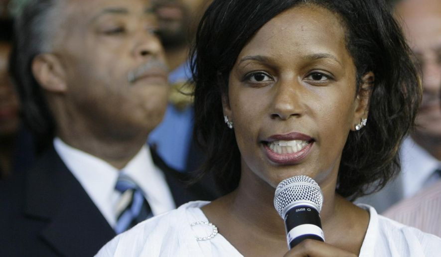 FILE - In this Aug. 1, 2007 file photo, Jeri Wright, president-elect of the Chicago chapter of Rev. Al Sharpton's New York based civil rights organization, the National Action Network, speaks during a press conference in Chicago. In the past three years, U.S. Attorney for the Central District of Illinois James Lewis's office, has dug up enough evidence of stolen taxpayer money to justify prison time for more than a dozen people, But the latest case invited biting, race-based criticism for Lewis by a potential witness who noted that 13 of the 14 people the unit has indicted since 2011 are black. Jeri Wright, was Convicted by jury of money laundering and false statements to authorities. (AP Photo/M. Spencer Green, File)