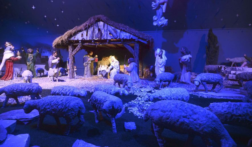 FOR RELEASE SATURDAY, DECEMBER 20, 2014, AT 12:01 A.M. CST. This photo taken Dec. 14, 2014, shows the Kaib Nativity Scene in Algona, Iowa, which is celebrating its 70th anniversary. (AP Photo/The Messenger, Jesse Major)