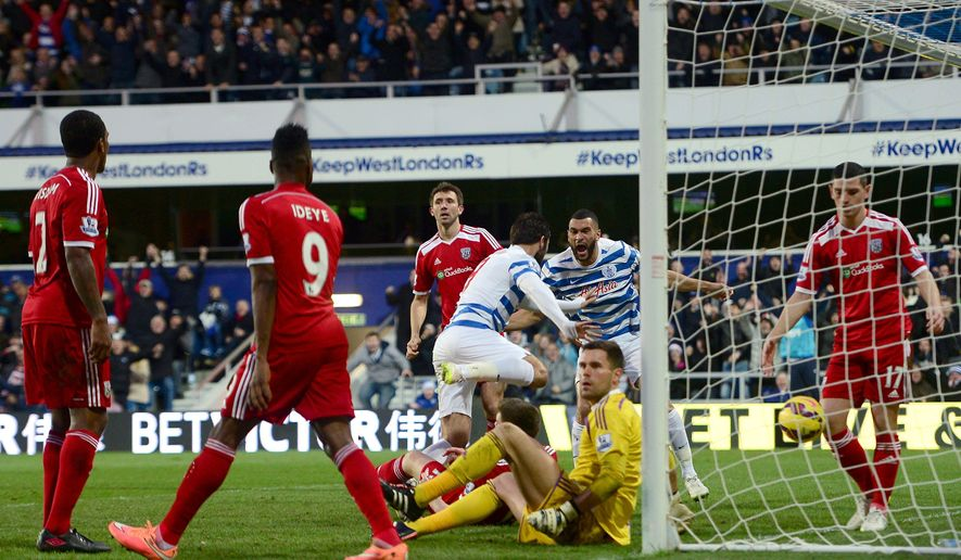 Queens Park Rangers' Charlie Austin centre,  celebrates with teammate Steven Caulker after scoring his side's second goal , during the English Premier League soccer match between QPR and West Bromwich Albion, at Loftus Road, in London, Saturday Dec. 20, 2014. (AP Photo/PA, Adam Davy) UNITED KINGDOM OUT