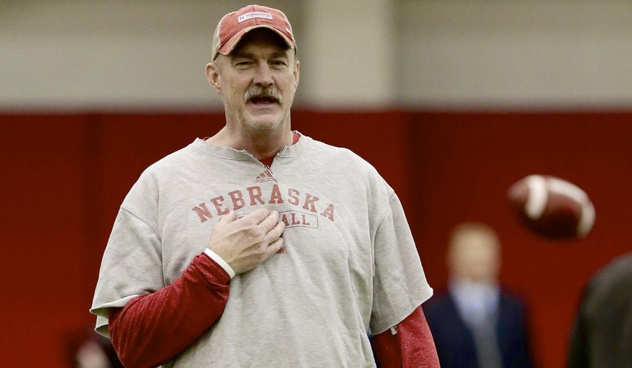 FILE -  In this file photo from Dec. 10, 2014, Nebraska interim head coach Barney Cotton follows NCAA college football practice in Lincoln, Neb. Cotton wants to accomplish the seemingly impossible task of maintaining a business-as-usual atmosphere in the wake of Bo Pelini's firing. He vows to make sure the players have the best experience possible at the Holiday Bowl, yet he still feels the punch in the gut from Pelini's firing and a sadness for assistant coaches left behind, most of whom don't know what the future holds after the Dec. 27 game against Southern California. (AP Photo/Nati Harnik)