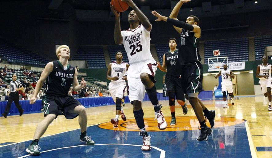 Mississippi State forward Roquez Johnson (25) attempts a layup as USC Upstate guard Fred Miller (32) defends in the first half of an NCAA college basketball game Saturday, Dec. 20,  2014, in Jackson, Miss. (AP Photo/Rogelio V. Solis)