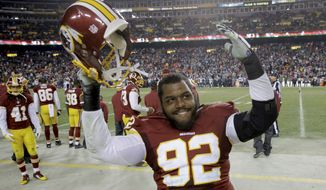Washington Redskins nose tackle Chris Baker (92) reacts to the team's win an NFL football game against the Philadelphia Eagles in Landover, Md., Saturday, Dec. 20, 2014. The Redskins defeated the Eagles 27-24. (AP Photo/Patrick Semansky)