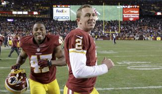 Washington Redskins kicker Kai Forbath (2) and defensive back Akeem Davis (47) leave the field after an NFL football game against the Philadelphia Eagles in Landover, Md., Saturday, Dec. 20, 2014. The Redskins defeated the Eagles 27-24. (AP Photo/Patrick Semansky)