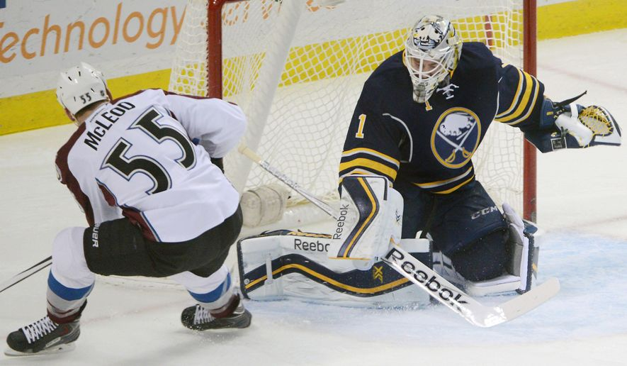 Colorado Avalanche left winger Cody McLeod (55) scores a short-handed goal on Buffalo Sabres goaltender Jhonas Enroth (1), of Sweden, during the first period of an NHL hockey game Saturday, Dec. 20, 2014, in Buffalo, N.Y. (AP Photo/Gary Wiepert)