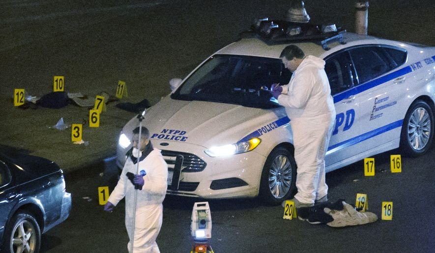 Investigators work at the scene where two NYPD officers were shot, Saturday, Dec. 20, 2014 in the Bedford-Stuyvesant neighborhood of the Brooklyn borough of New York. Police said an armed man walked up to two officers sitting inside the patrol car and opened fire before running into a nearby subway station and committing suicide. Both police officers were killed. (AP Photo/John Minchillo)