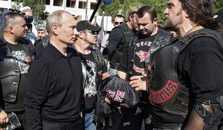 Russian President Vladimir Putin, left, speaks with members of the Night Wolves biker group in the Crimean Peninsula, Ukraine,  July 12, 2012. (Associated Press) ** FILE **